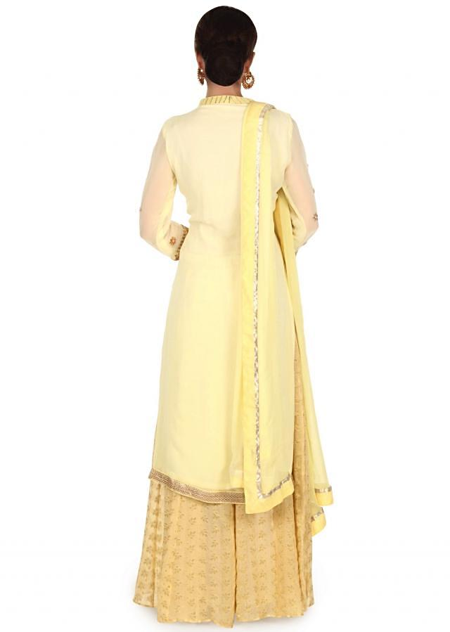 Lime yellow straight suit adorn n gotta patch work only on Kalki