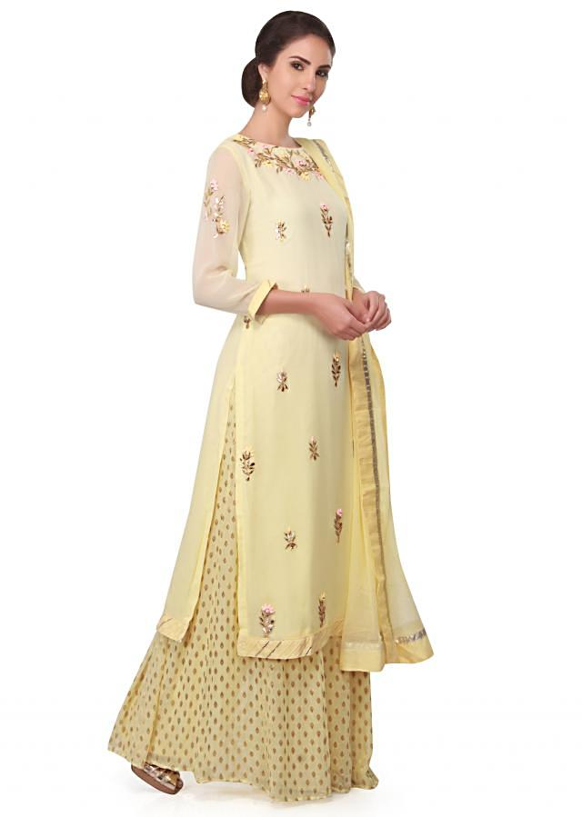 Lime yellow straight suit embellished in resham and gotta lace only on Kalki