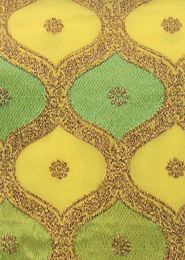 Lime yellow unstitched suit adorn in resham and zari weave only on Kalki