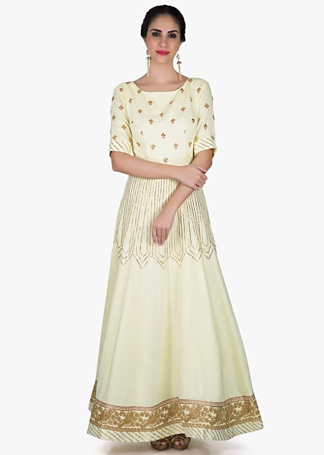 Lime yellow anarkali in silk embellished in gotta lace and gotta patch embroidery only on Kalki