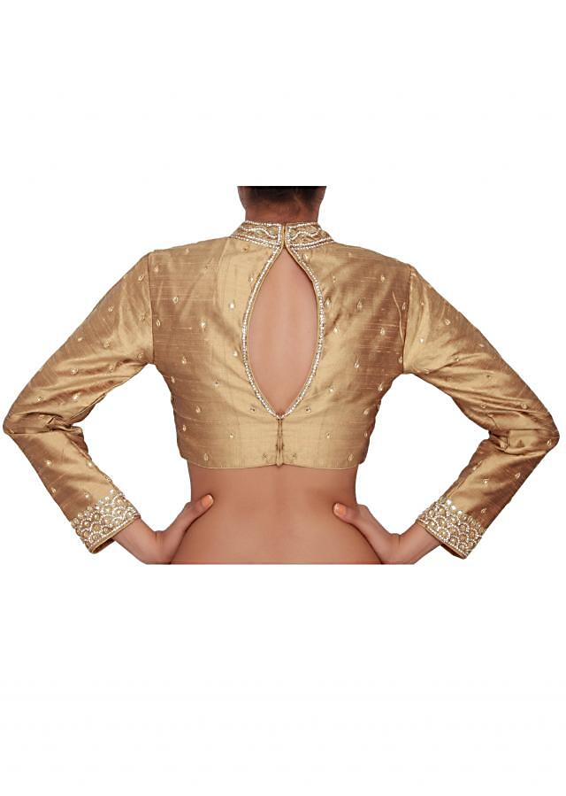 Liquid gold blouse featured in raw silk, embellished with gold and silver stone work only on Kalki