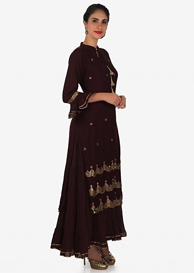 Long dress in dark maroon adorn in fancy tassel and sequin embroidery only on Kalki