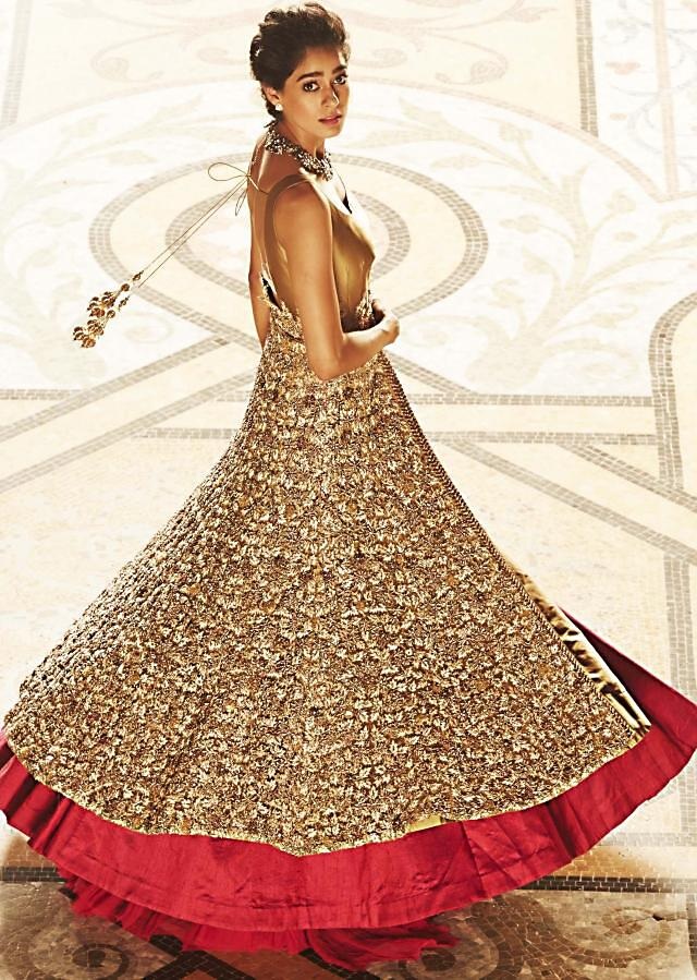 Long jacket lehenga in beige and gold enhanced in beads and sequin embroidery only on Kalki