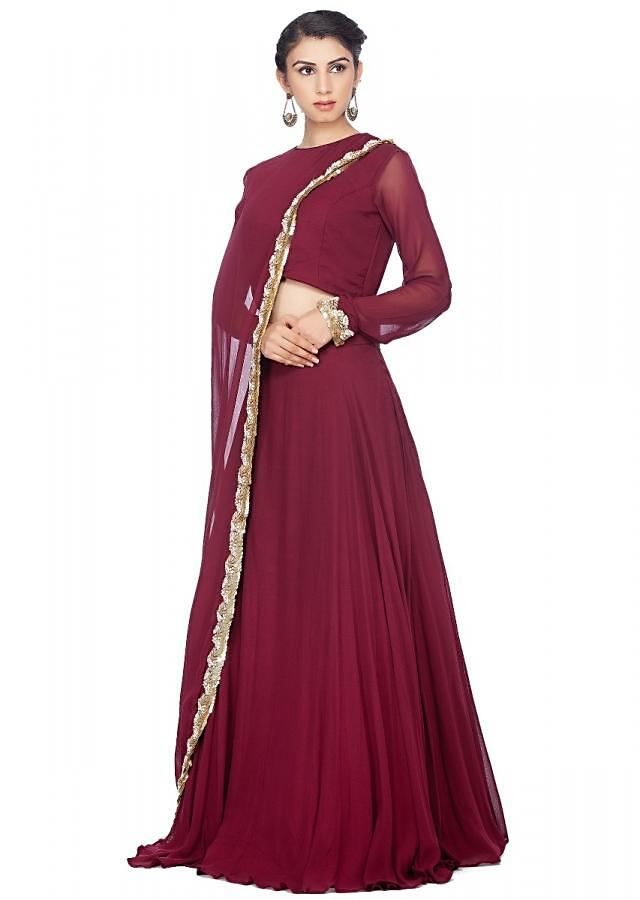 Magenta lehenga feautring in georgette with fancy attached cape in moti embroidered border