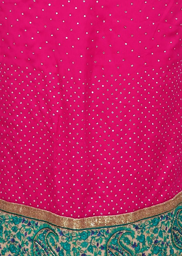 Magenta pink unstitched suit adorn in resham embroidered border only on Kalki