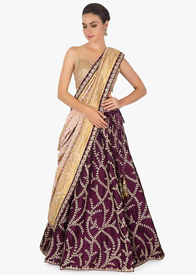 Magenta silk lehenga  embellished with gotta patti  patch work all over matched with a contrasting pink brocade dupatta only on kalki