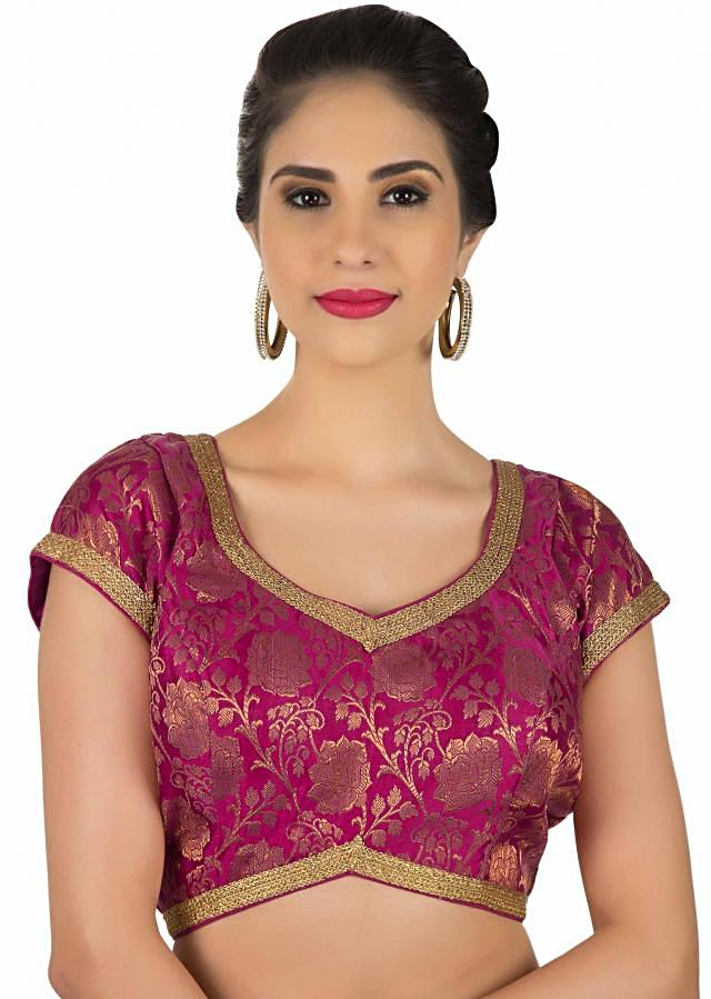 Magenta brocade blouse with lace piping only on Kalki