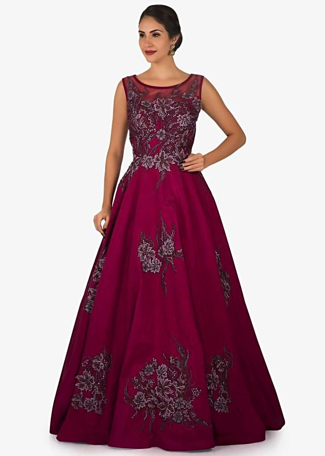 Magenta gown in silk beautified in resham floral motif butti work only on Kalki