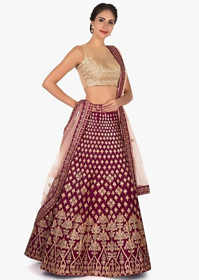 Magenta lehenga in silk featuring the foil print butti embroidery work only on Kalki