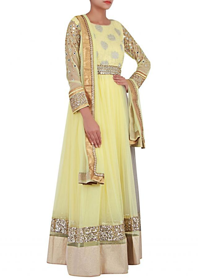 Maize yellow net anarkali suit enhanced in thread and zari only on Kalki