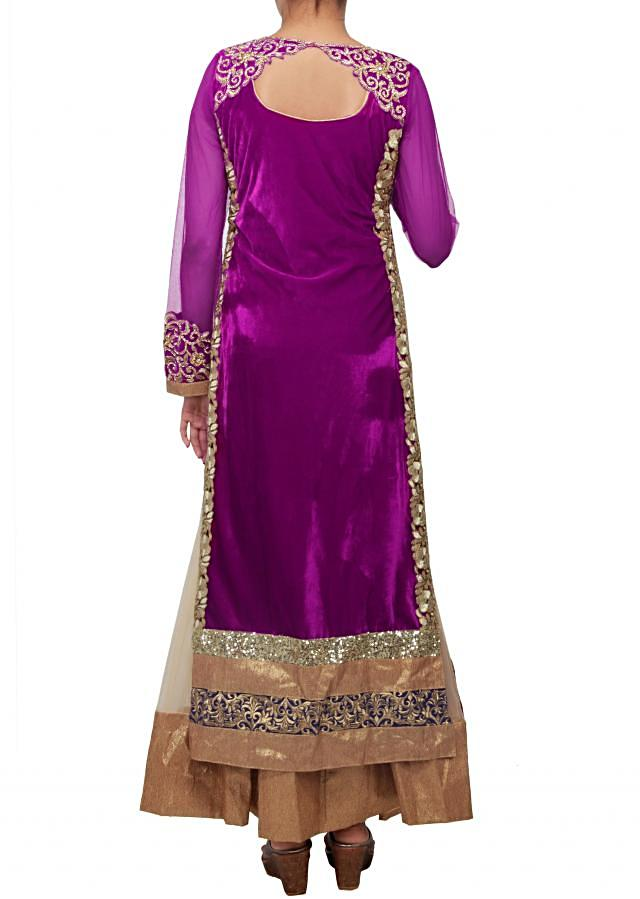 Anarkali suit featuring in purple wine shade enhanced in stone and kundan work only on Kalki