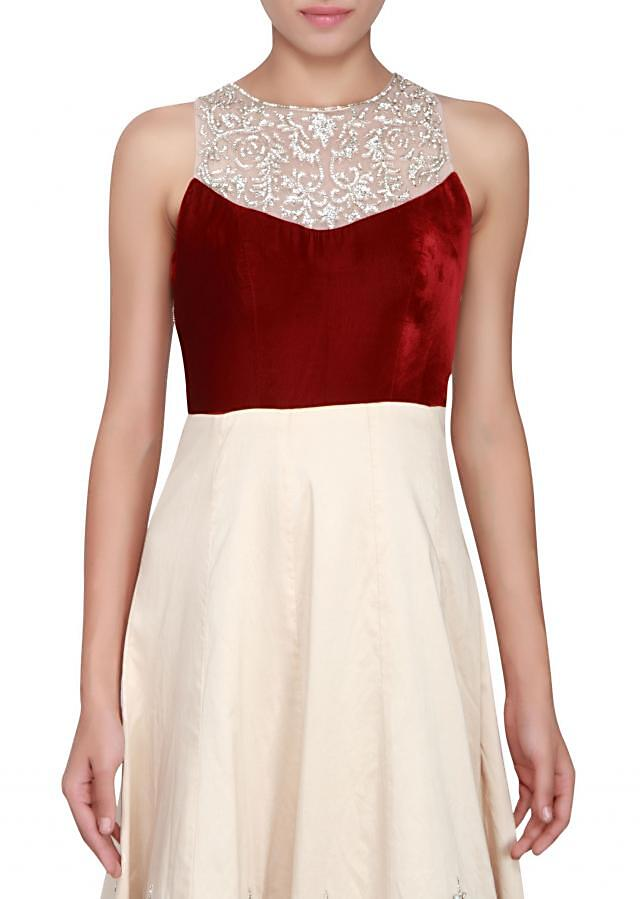 Maroon and cream gown featured in velvet and satin silk embellished in stone only on Kalki