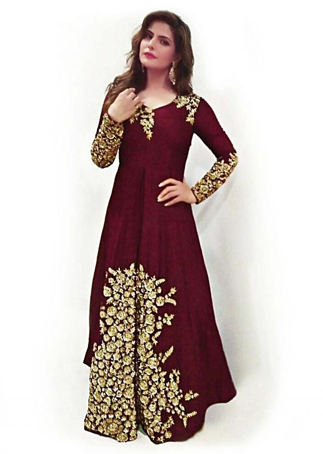 Maroon gown adorn in gold zari at sleeve and hem only on Kalki