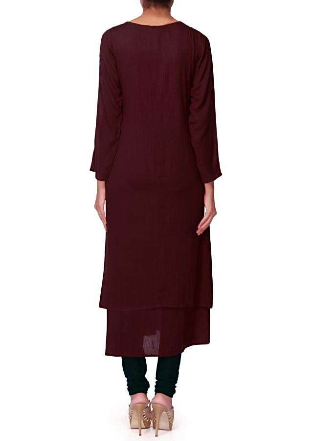 Maroon kurti with fancy button and pom pom lace only on Kalki