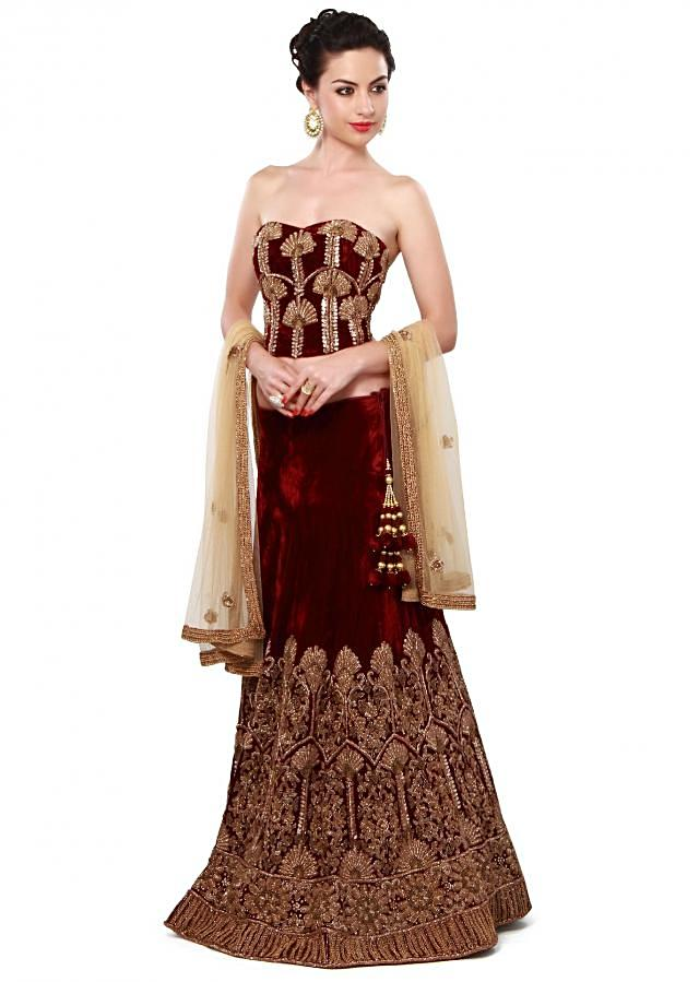 Maroon lehenga matched with corset blouse only on Kalki