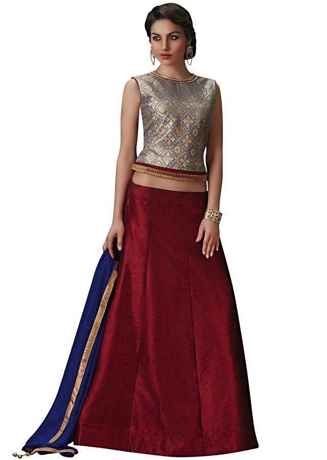 Maroon lehenga with grey silk blouse in embroidered neckline