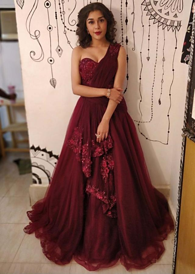 Eisha Singh Maroon net gown with one side shoulder and bodice in 3 D flower only on Kalki