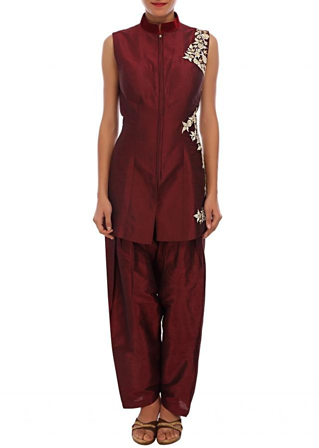 Maroon raw silk suit embellished in zari embroidery only on Kalki