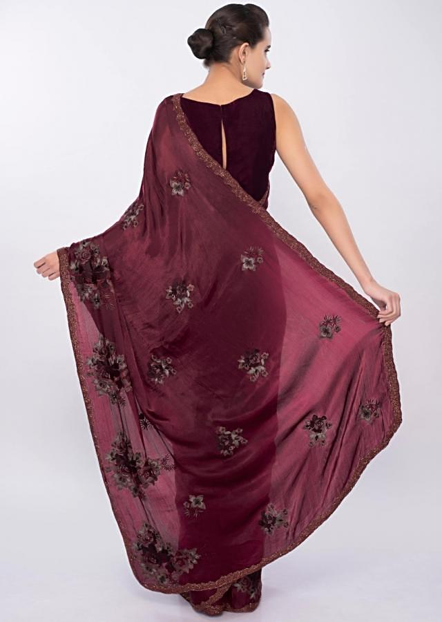 Maroon satin chiffon saree in floral resham embroidered along with cut dana and moti only on Kalki