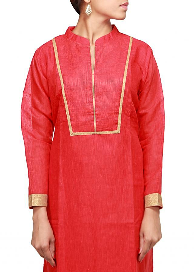 Maroon straight fit suit enhanced in thread work only on Kalki