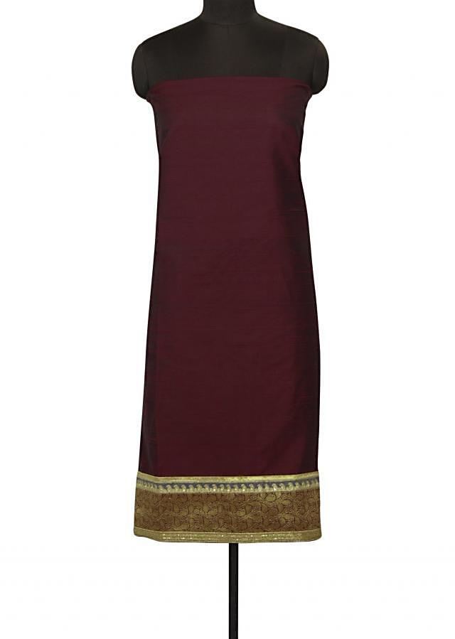 Unstithced suit in maroon with embroidered hem line only on Kalki