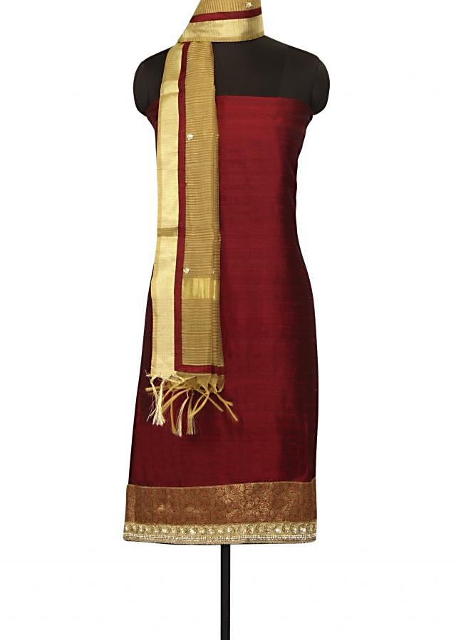 Maroon unstithced suit in brocade hem line and sequin only on Kalki