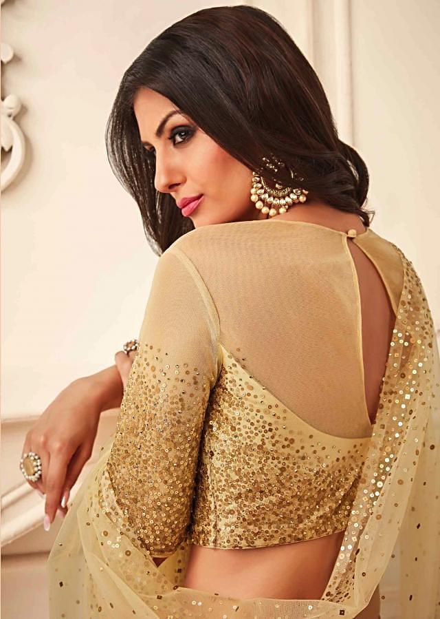 Maroon and beige lehenga in raw silk and net embellished in scatered sequin embroidery
