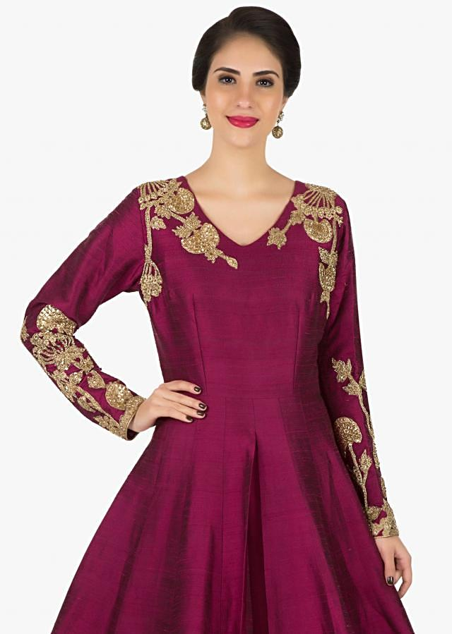 Maroon silk gown featuring the heavy cutdana and sequin embroidery only on Kalki