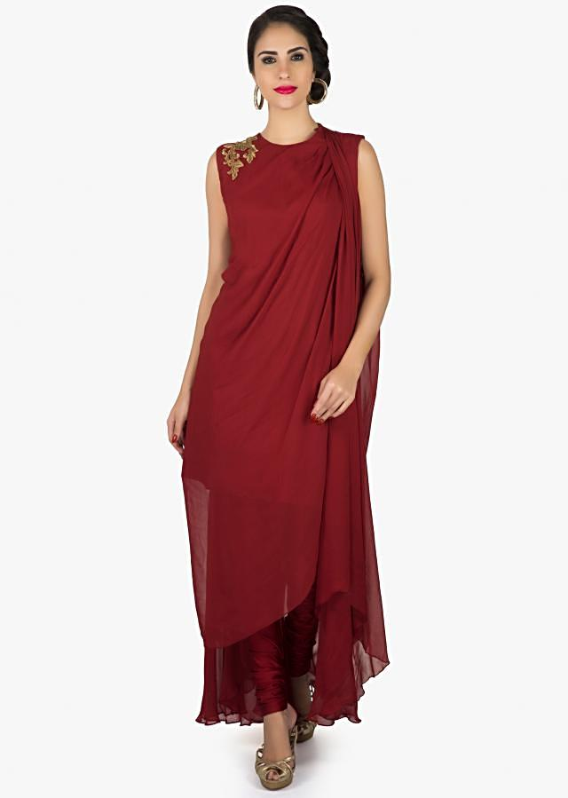 Maroon suit in georgette with fancy drape and embroidered zari butti only on Kalki