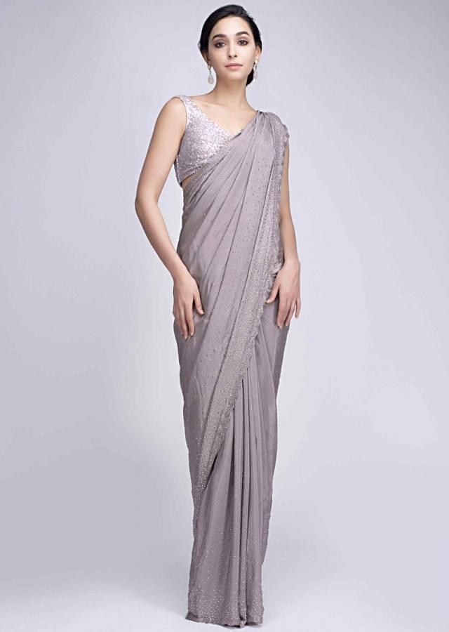 Mauve grey satin crepe saree with scattered kundan all over only on Kalki