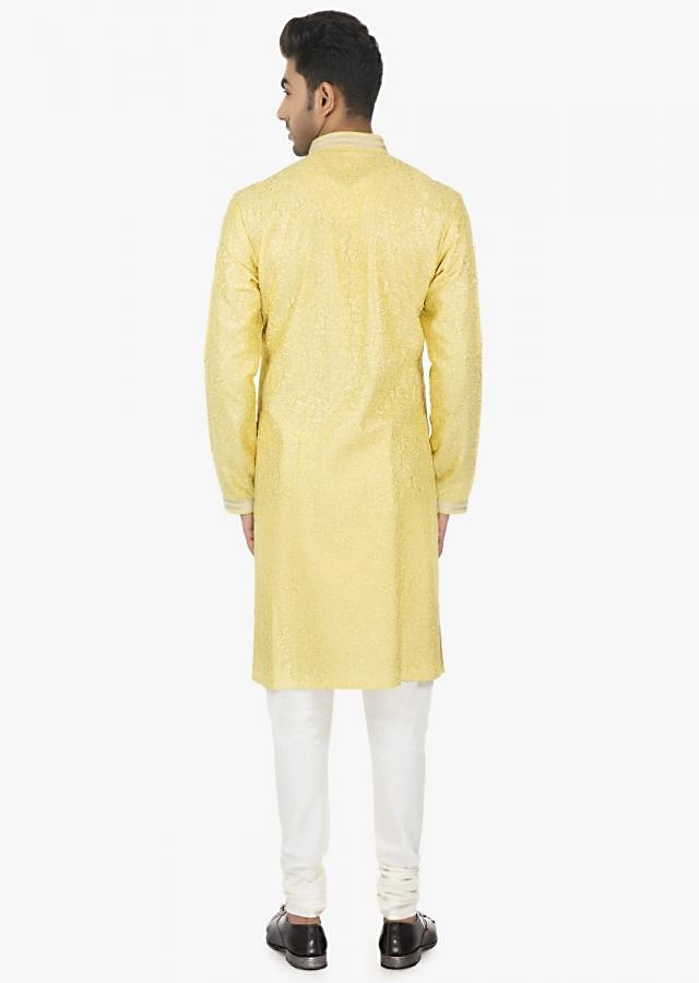Mellon Yellow full sleeves kurta with thread work all over matched with White polyester silk chudidar set only on Kalki