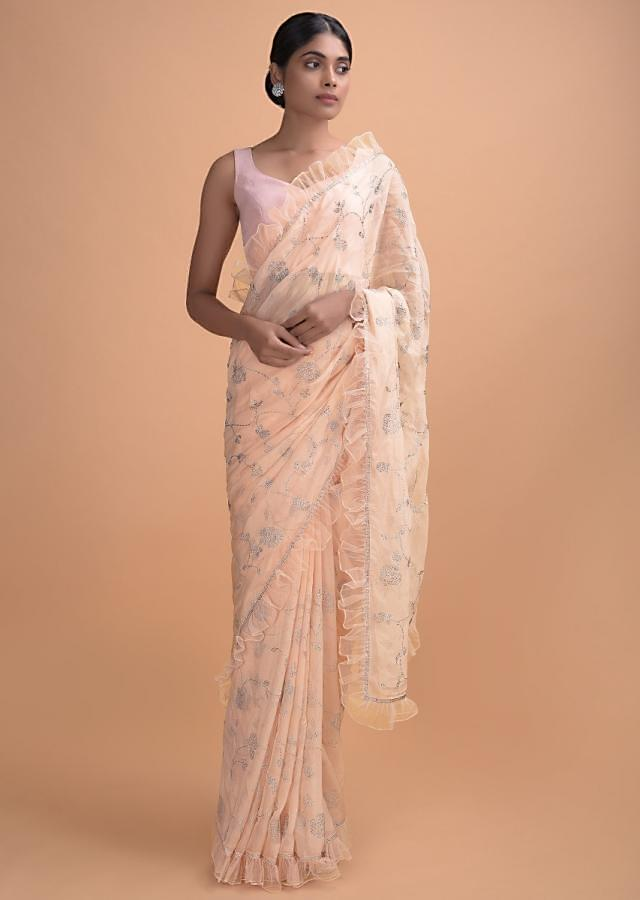 Melon Peach Saree In Silk With Ruffled Border And Kundan Work In Floral And Leaf Online - Kalki Online