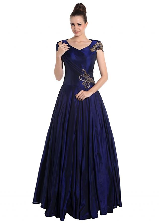 Midnight blue dupion silk gown adorned with cut dana work only on Kalki