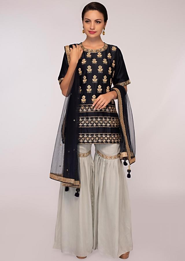 Might night blue suit paired with cloud grey cotton sharara pant only on Kalki