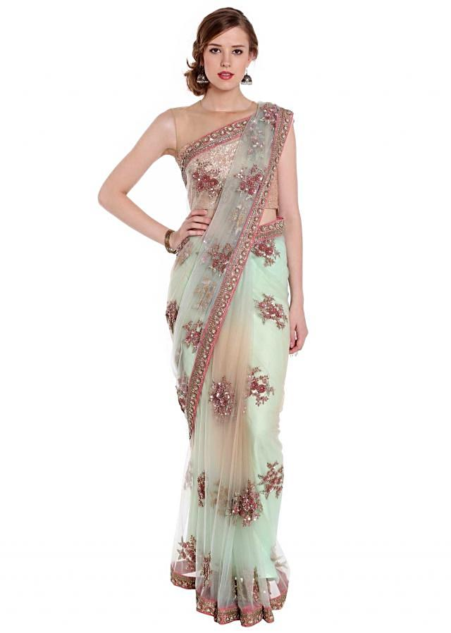 Mint and cream shaded embroidered saree with fancy tassel only on Kalki