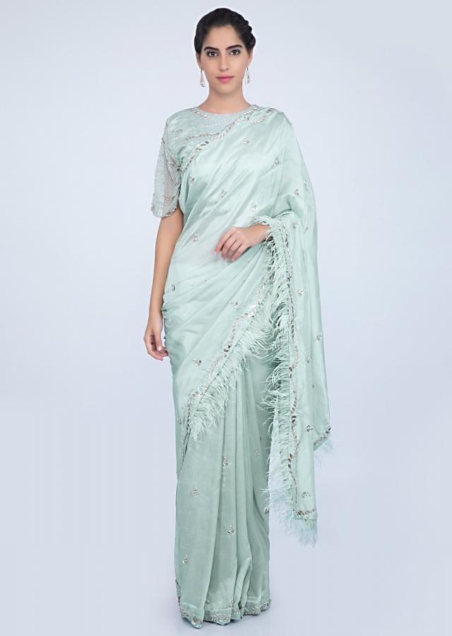 Mint blue embroidered silk saree with feathers only on kalki
