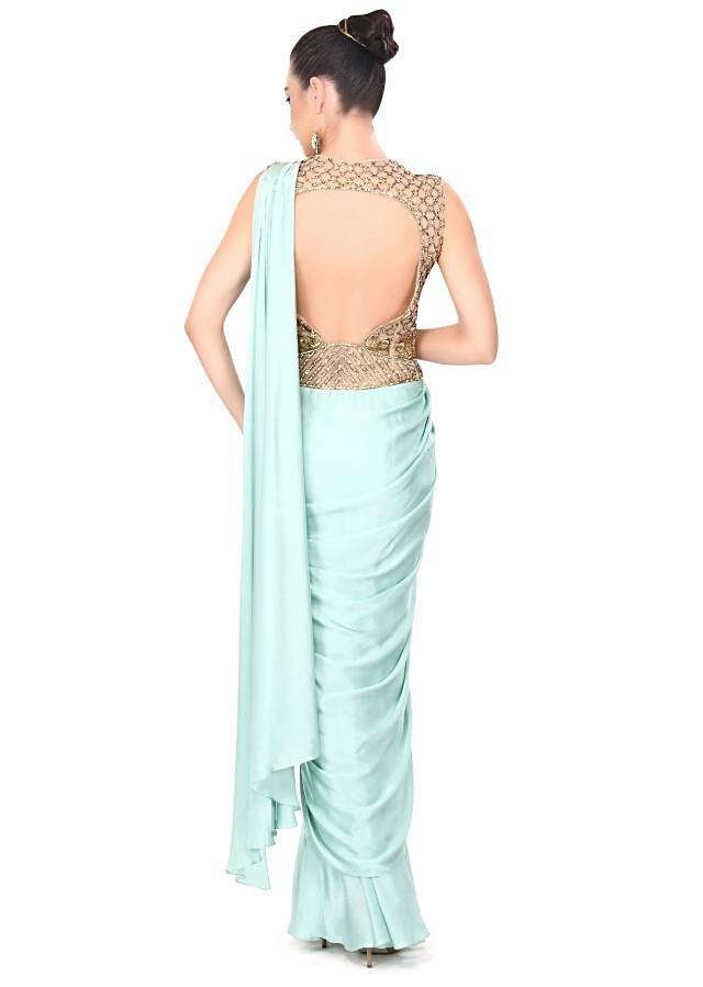 Mint blue gown enhanced in zari and kundan embroidery only on Kalki