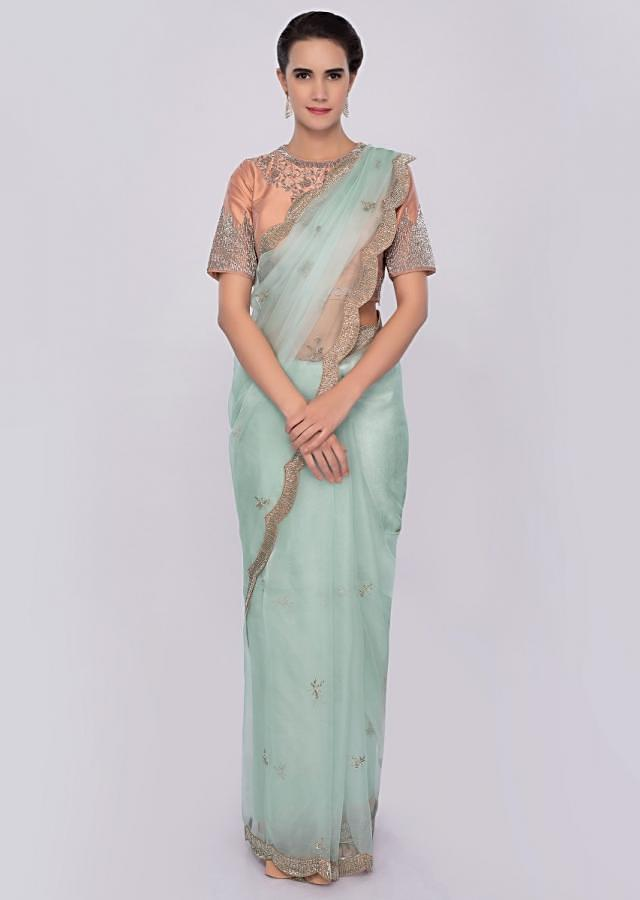 Mint blue organza saree with embroidered peach blouse only on Kalki