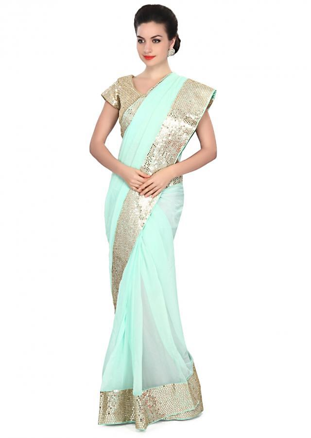 Skylight blue saree embellished in mirror and zari embroidery only on Kalki