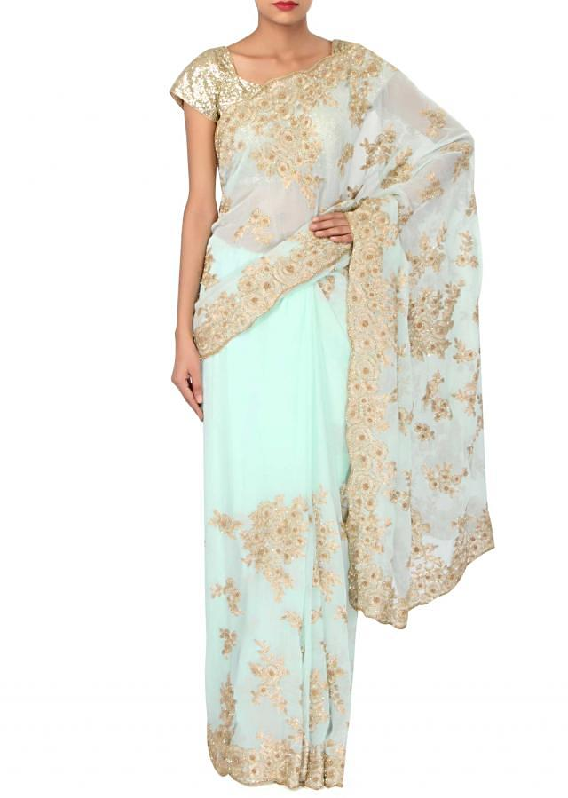 Mint blue saree embellished in zari embroidery only on Kalki