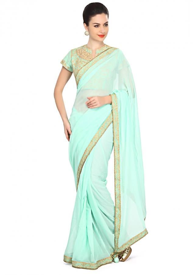 Mint blue saree featuring in embellished border only on Kalki
