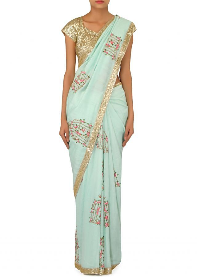 Mint blue saree with cage motif embroidery only on Kalki