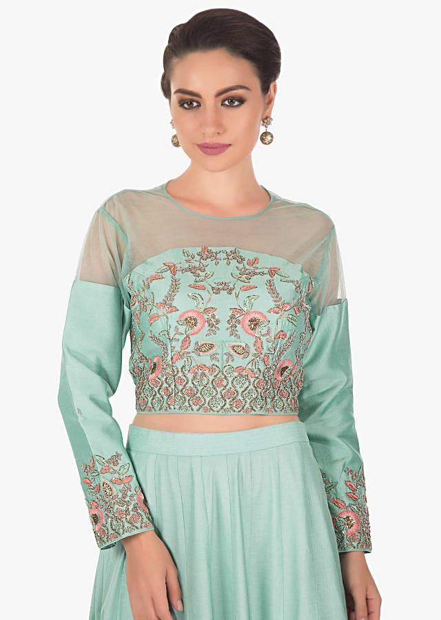 Mint  green cotton lehenga featuring with  net yoke embroidery and resham  French knot . Matched with a mint net dupatta only on kalki