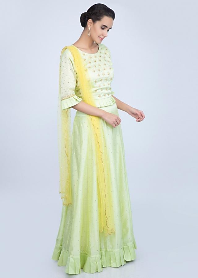 Mint green cotton silk lehenga and blouse paired with a contrasting yellow net dupatta only on Kalki