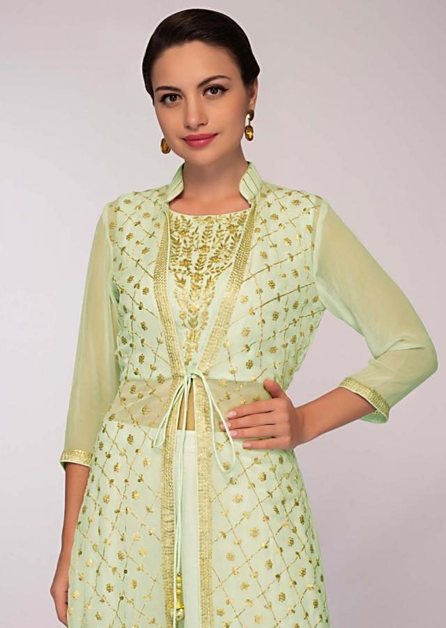 Mint green cotton skirt paired with embroidered long jacket and matching chiffon dupatta only on Kalki