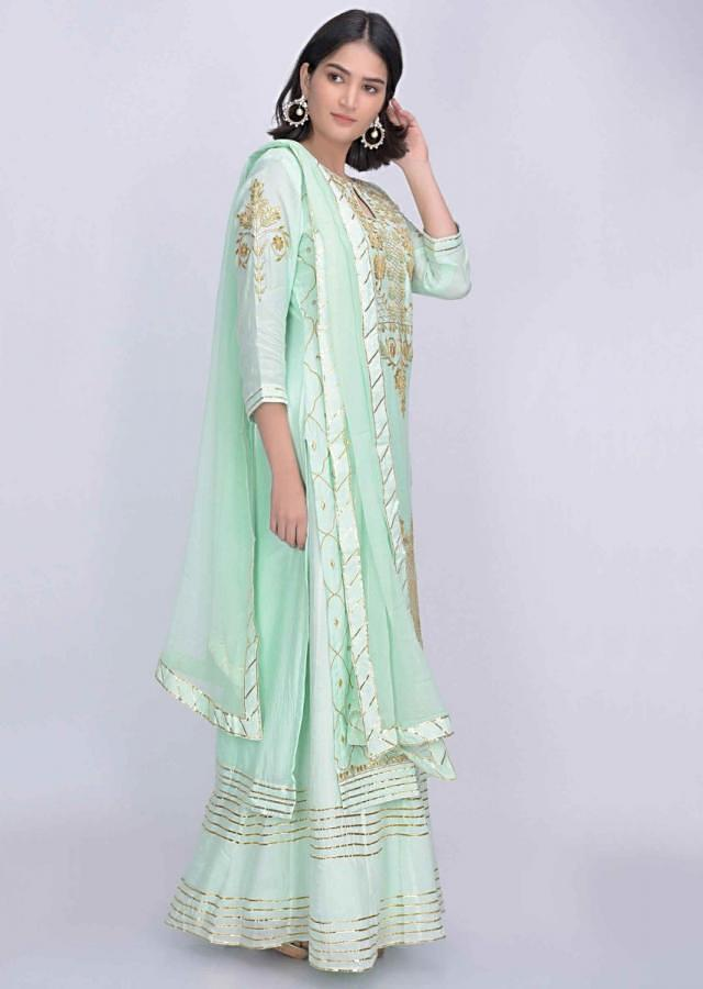 Mint green crepe straight cut suit with matching skirt bottoms only on Kalki