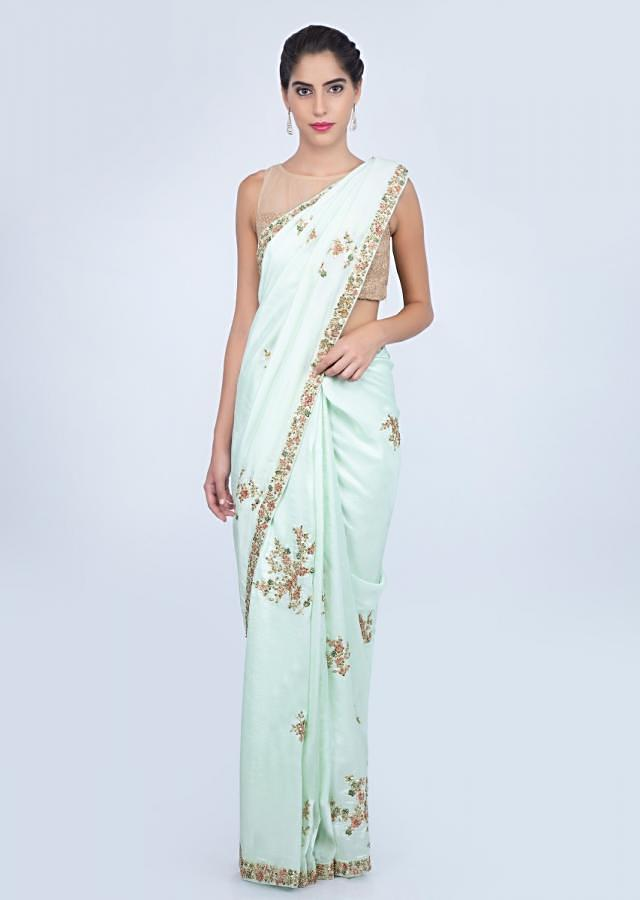Mint green dupion silk saree with embroidered butti and border only on kalki