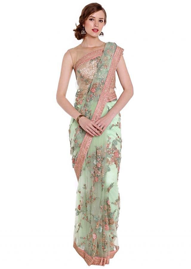 Mint green embroidered net saree in floral jaal motif only on Kalki