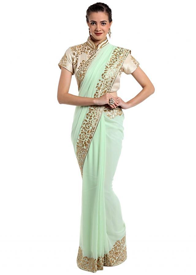 Mint green georgette saree adorned with applique work only on Kalki