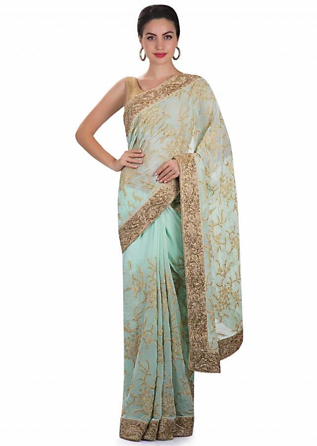 Mint green georgette saree adorned with thread work and cut dana only on Kalki